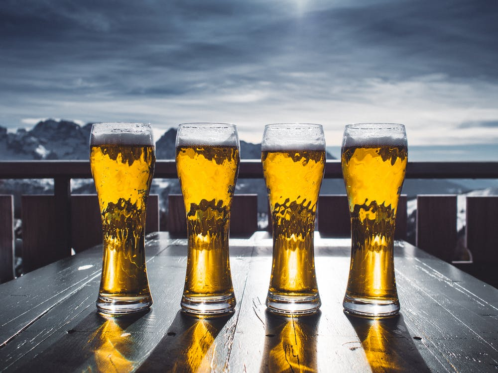 Four Pint Glasses Filled With Beer
