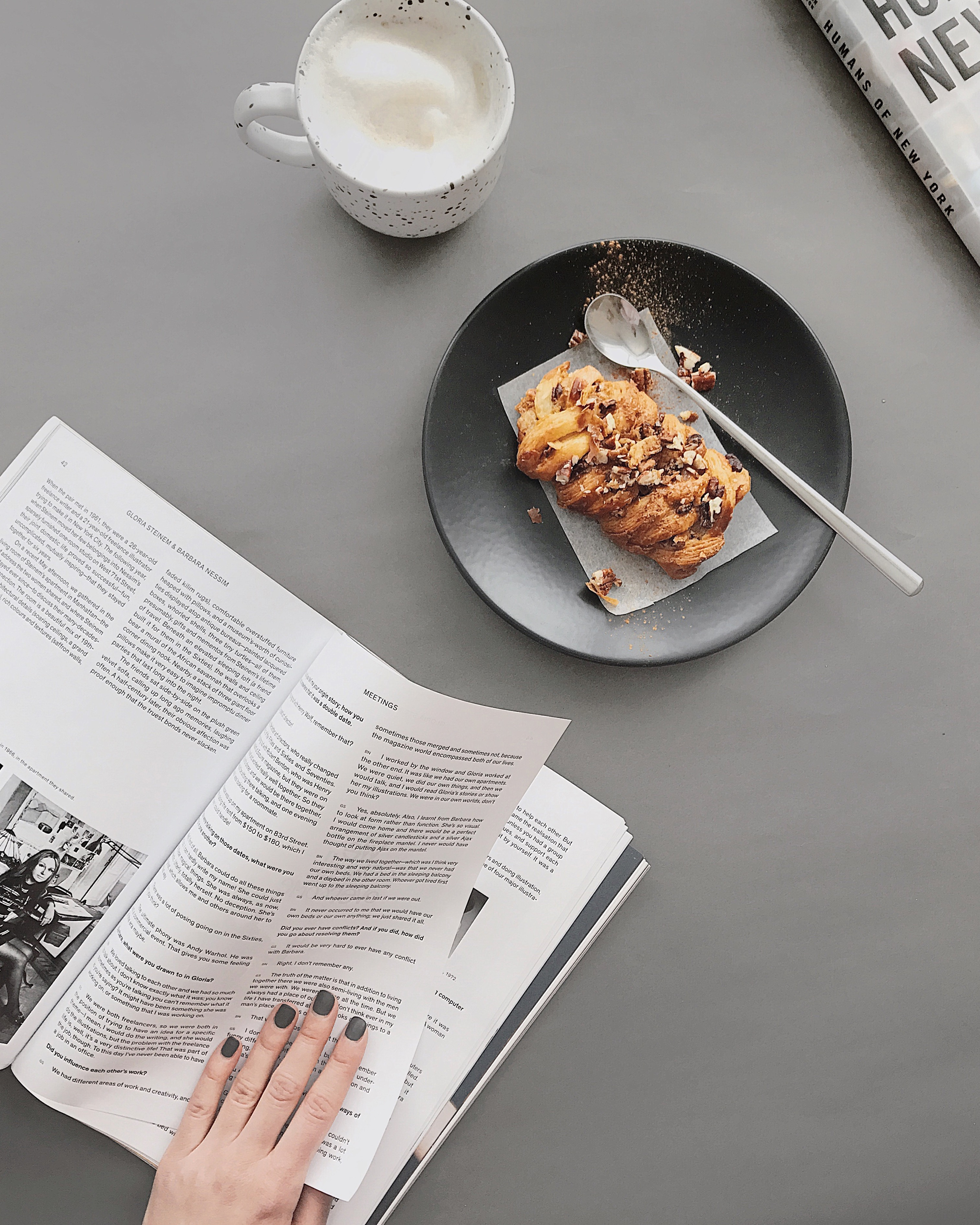 bread on round black plate near white ceramic cup