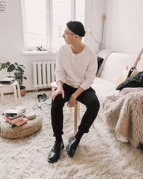 Man Wearing White Sweater With Black Pants