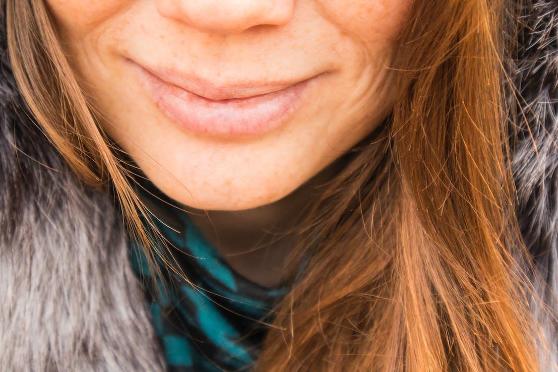 Smiling Woman Wearing Gray Fur Top