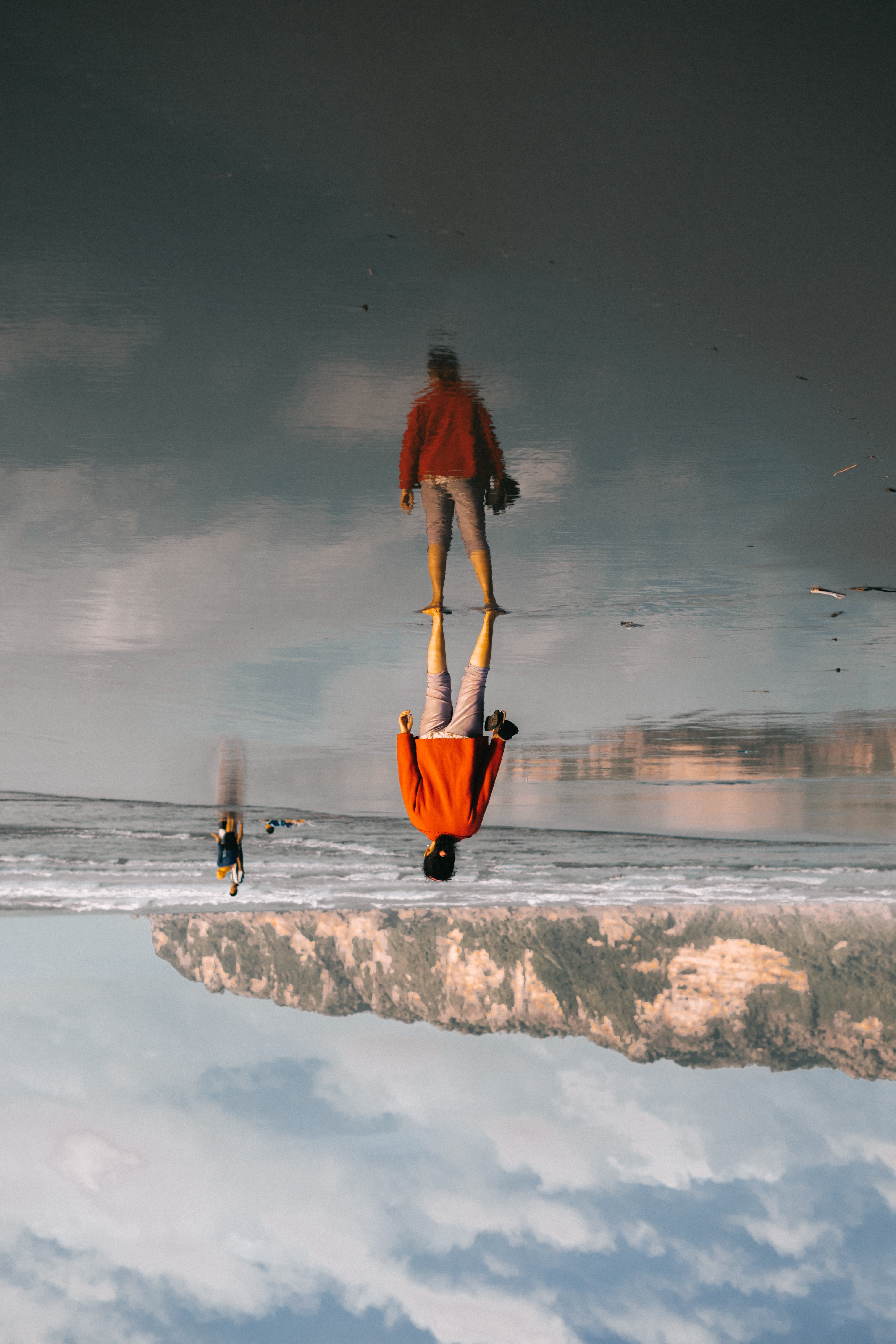 Person Standing on Body of Water Image during Day