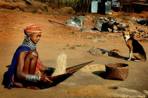 Tribal Woman holding Woven Tray