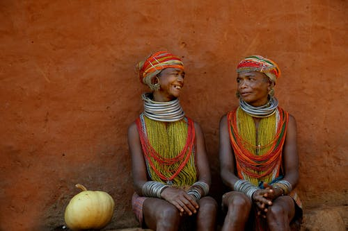 Tribal Women seated Together