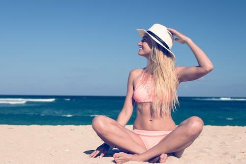 Woman in Pink Bikini at the Beach