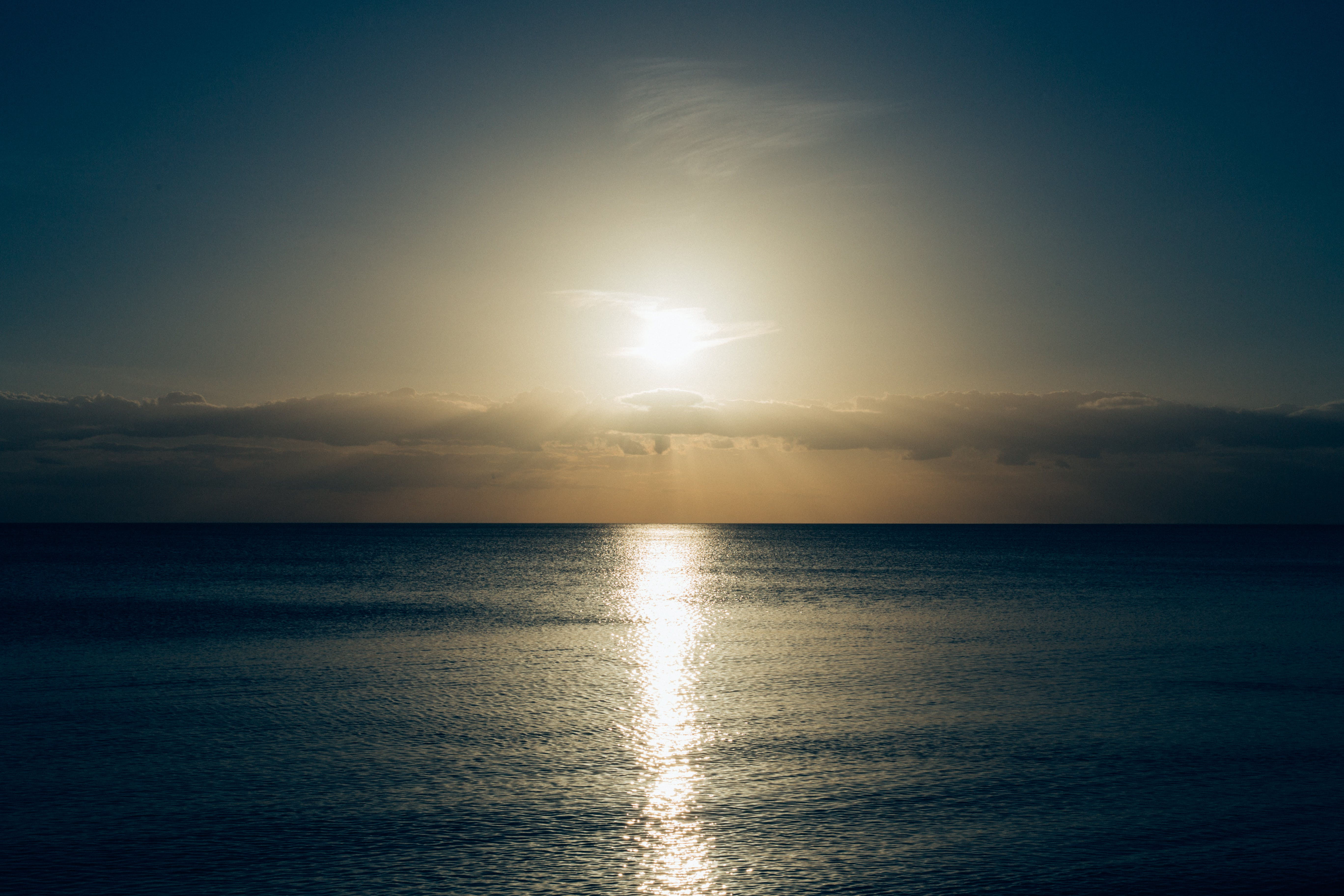 Calm Sea With Sun Setting Photo