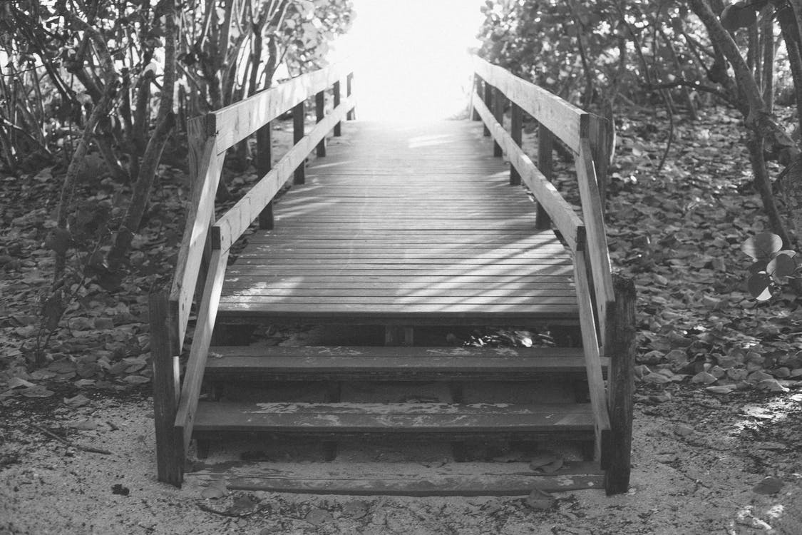 Grayscale Photography of Wooden Stairs