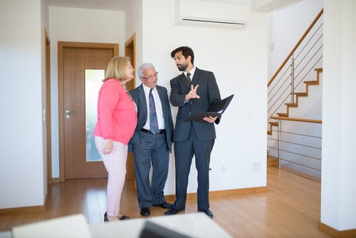 Elderly Couple talking to a Real Estate Agent