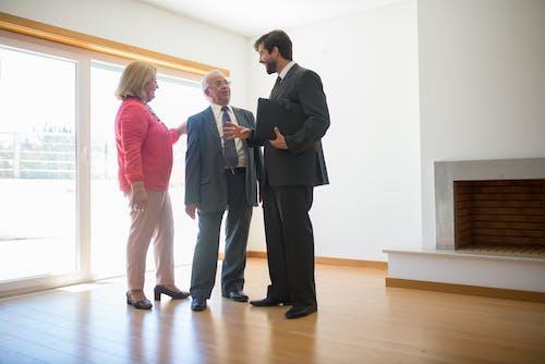 People Talking Inside an Empty House