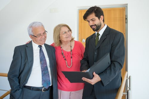 Real Estate Agent  talking to an Elderly Couple
