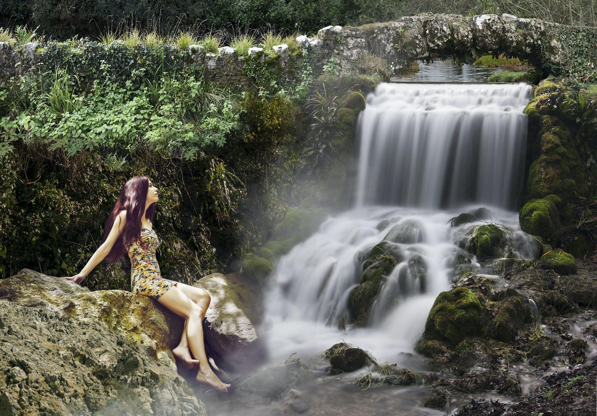 Free stock photo of bridge, girl, Mossy rocks, waterfall