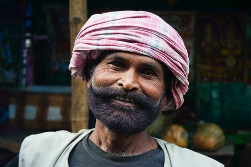 Man Wearing Pink Turban Headdress Smiling