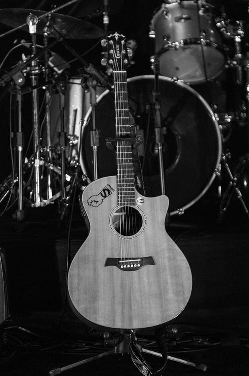 Grayscale Photo of an Acoustic Guitar