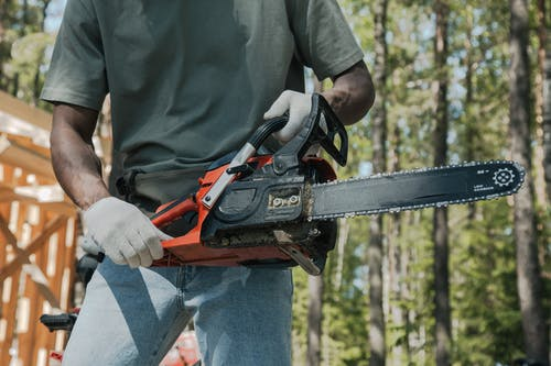 A Person Holding a Chainsaw