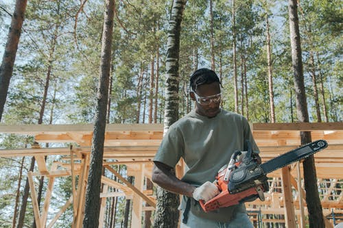 A Man Holding a Chainsaw