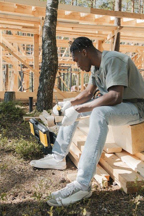 A Man Sitting on Wood Planks