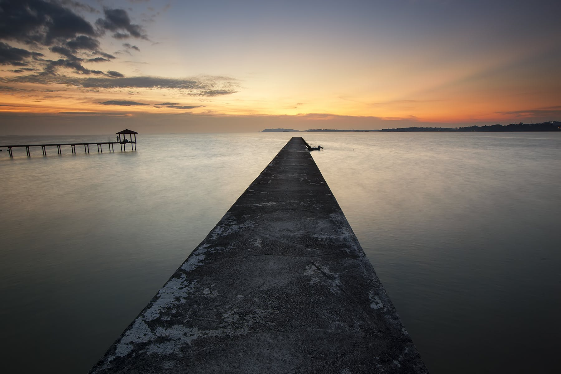 Brown Dock Beside Body of Water during Sunrise