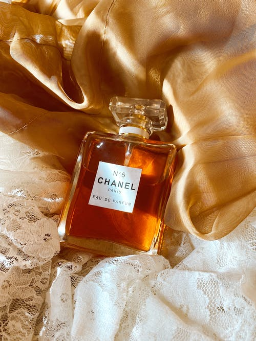 Luxurious Perfume Bottle on a Golden Silk Textile