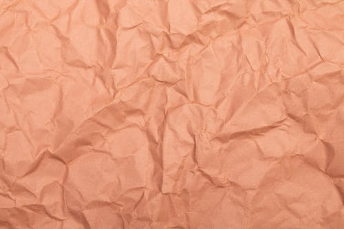 Close-up Photo of Crinkled Beige Paper