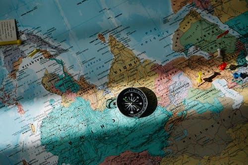 Black Round Analog Watch on Map