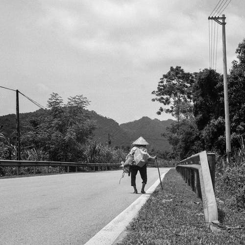 Grayscale Photo of 2 Person Walking on Road