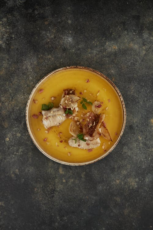 Soup in Yellow Ceramic Bowl