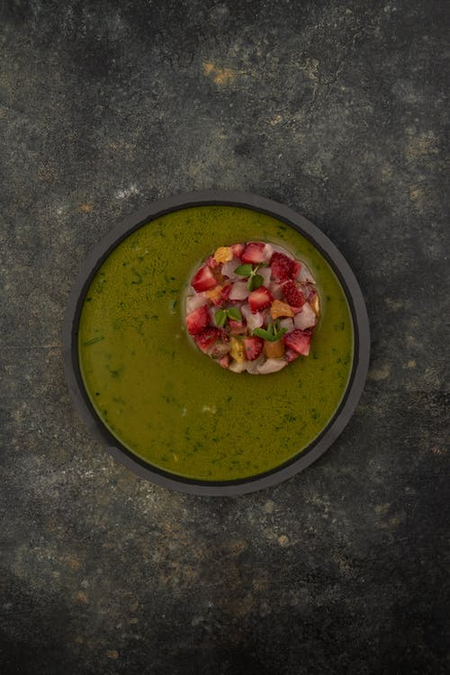 Green Soup in Black Round Bowl