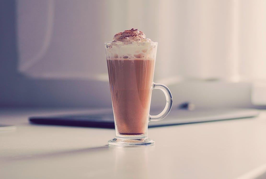Brown Liquid in Clear Glass Mug