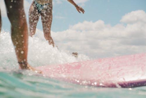 Woman in Blue and White Bikini on Water