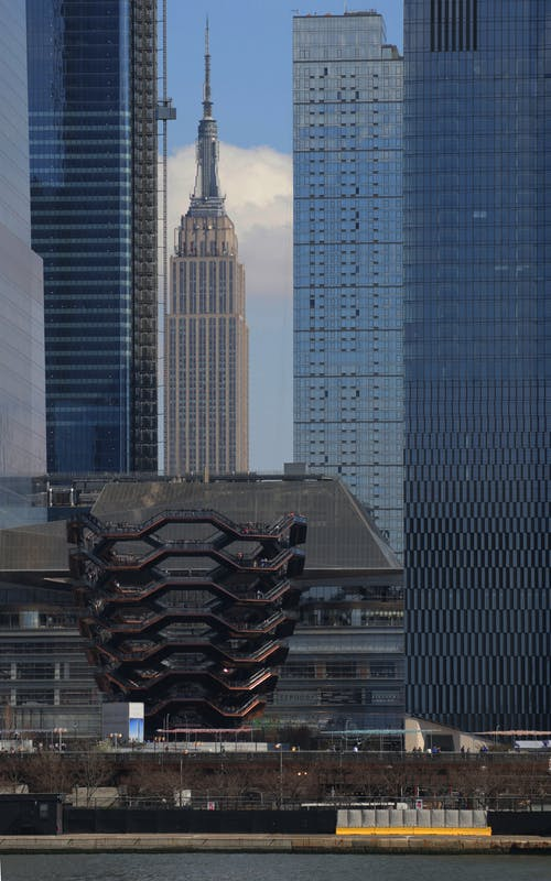 Black Metal Building Roof Near High Rise Buildings