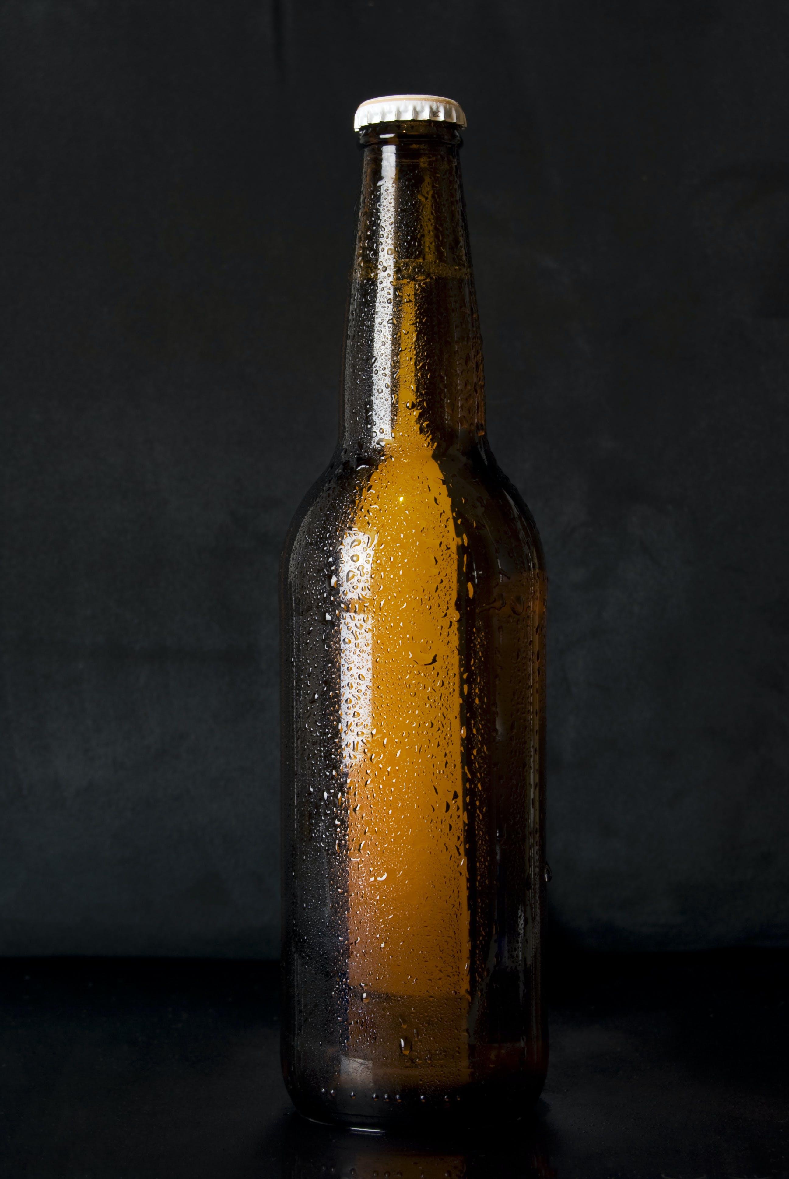 Amber Glass Bottle Standing on Black Surface