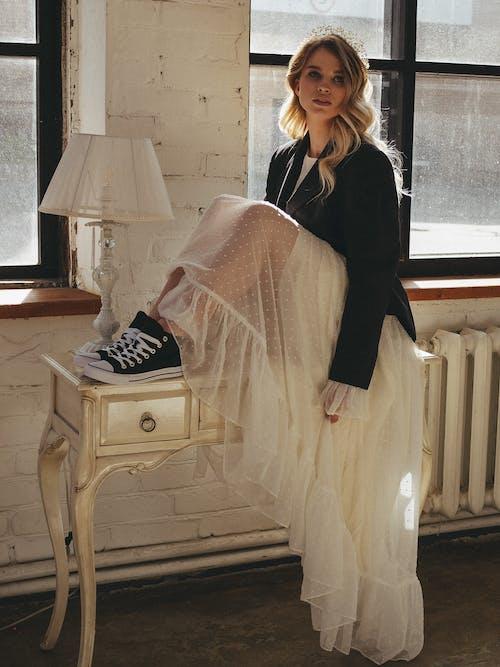 A Woman Wearing a Long Sheer Fabric Skirt