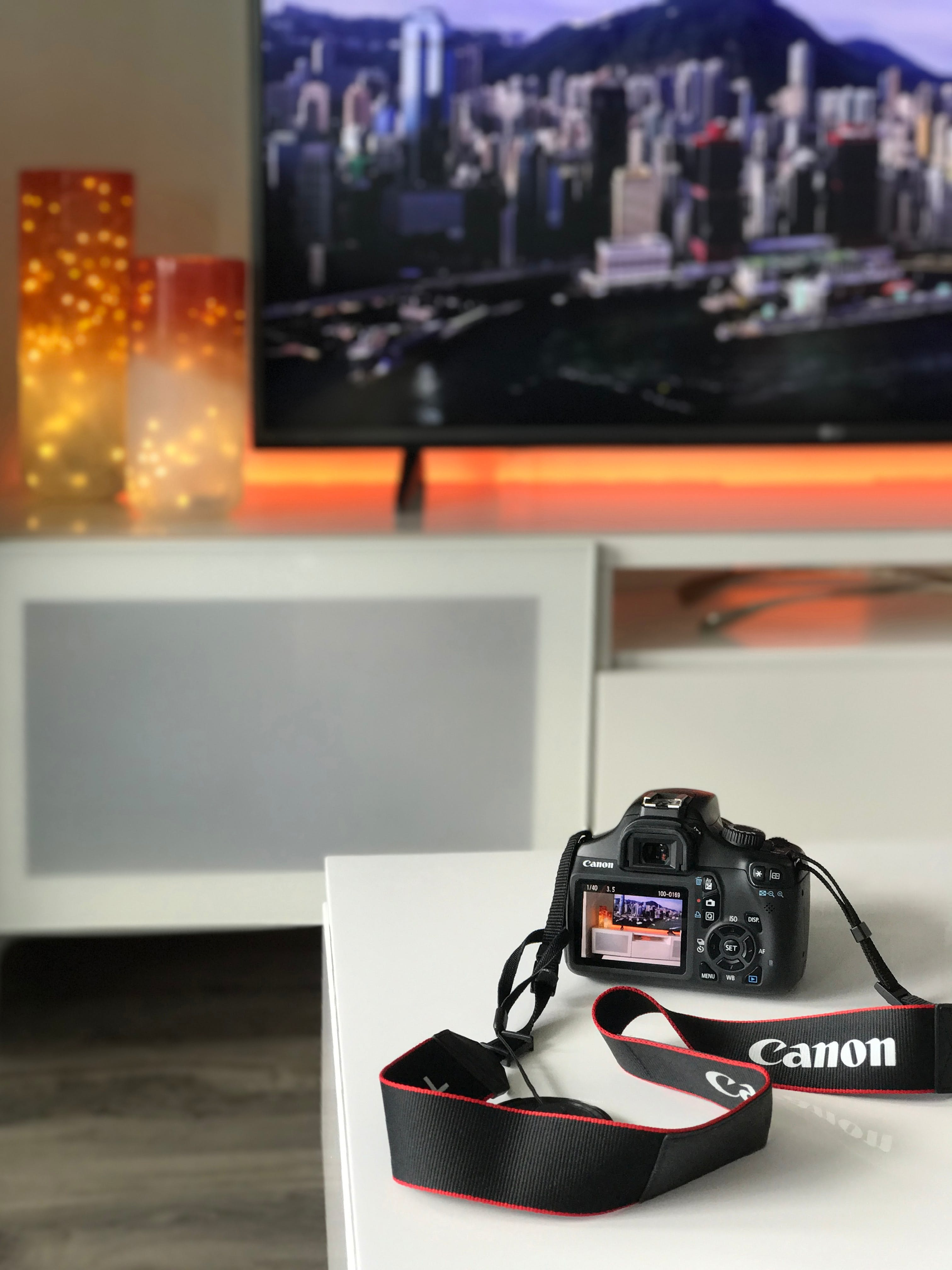 Black Canon Camera on White Wooden Table
