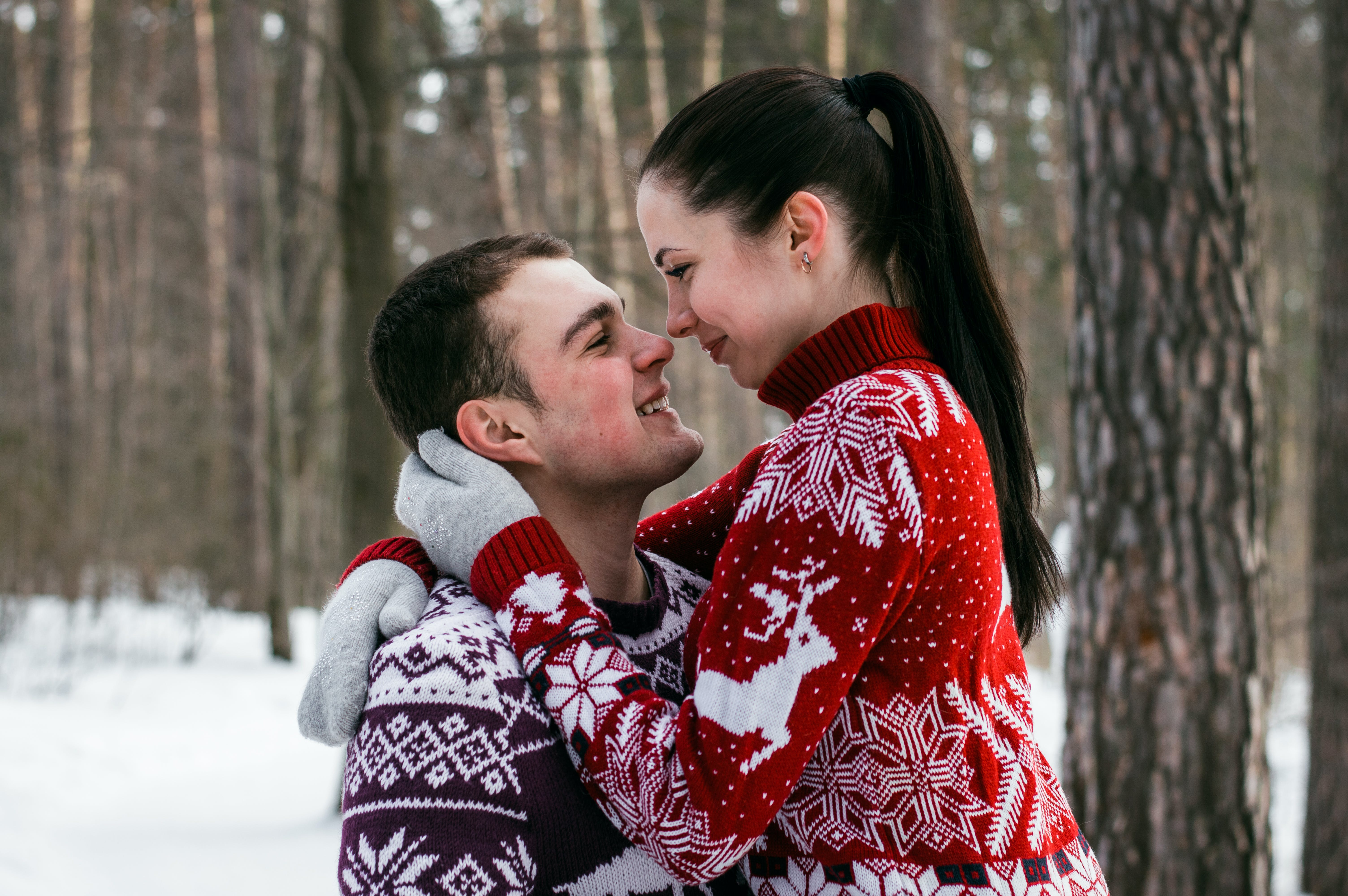 Couple Cuddling on the Middle of Ice Forest
