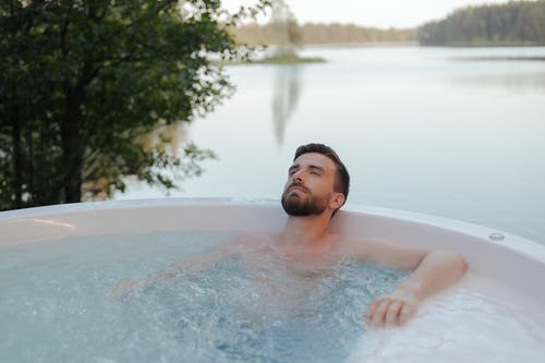 Handsome Man Relaxing in a Jacuzzi