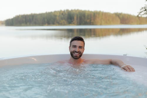 Smiling Man Relaxing in a Jacuzzi