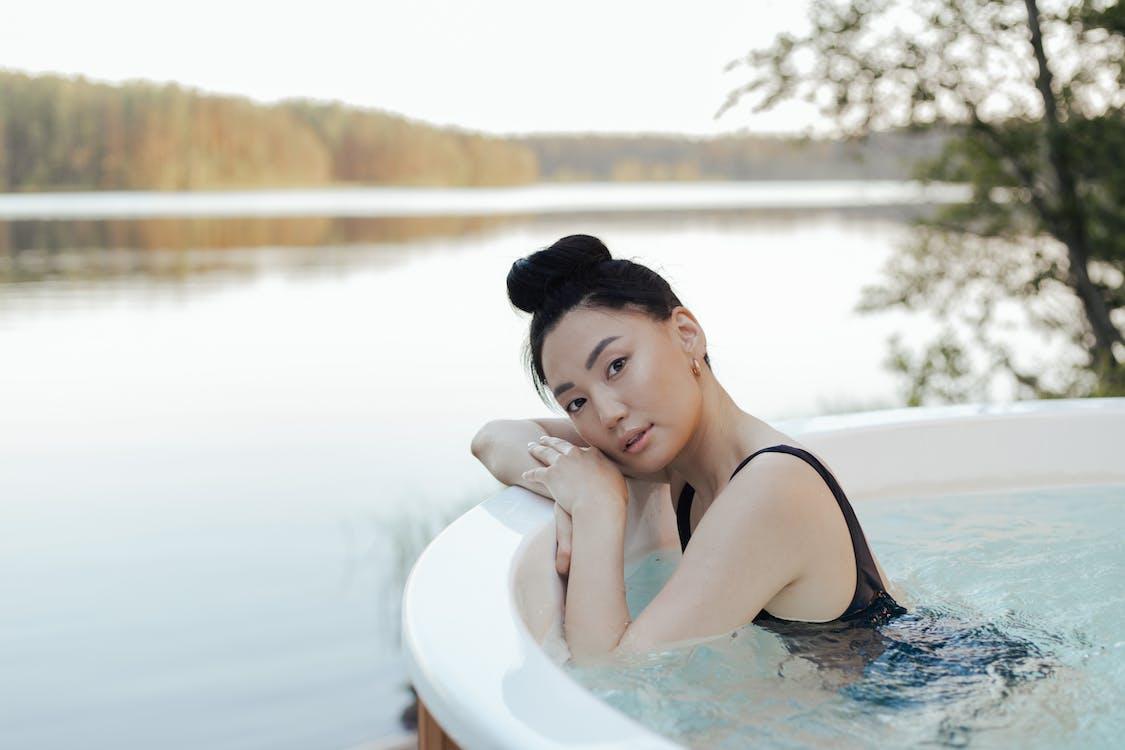 Woman in Black Swimwear Relaxing in a Jacuzzi