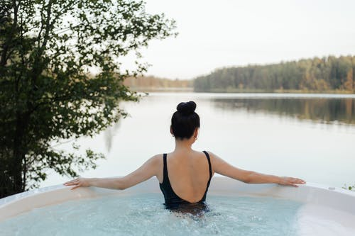 Person Relaxing in a Jacuzzi