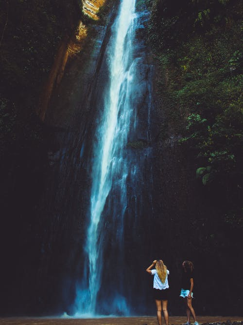 Two Women Near Waterfalls