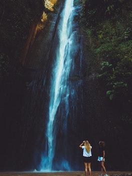 Two Women Near Waterfalls