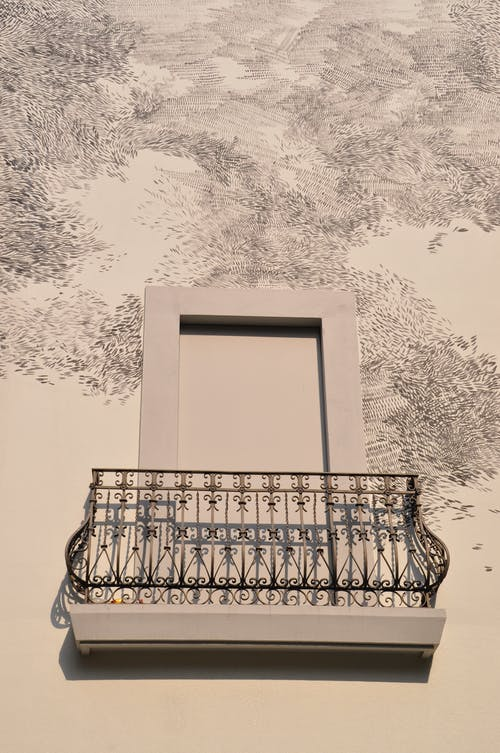 Free stock photo of balcony, evening sun, murals, shadows