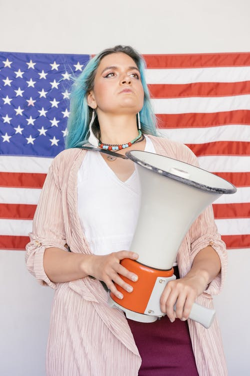 Woman Looking Up while Holding Megaphone