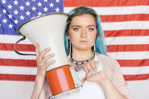 Close Up Photo of Woman Holding a Megaphone