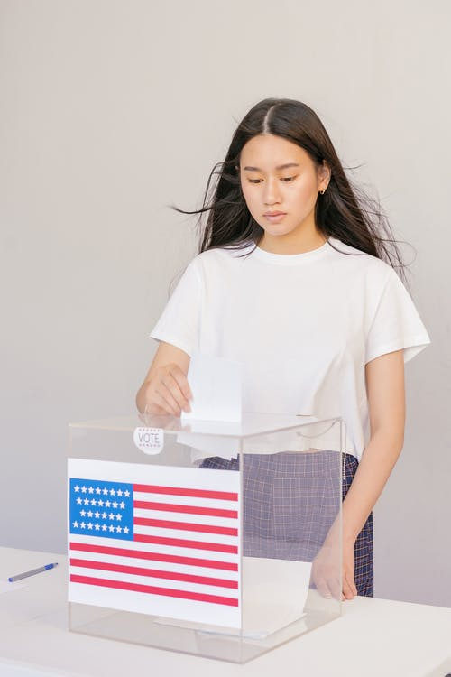 Woman Putting her Vote on Ballot Box