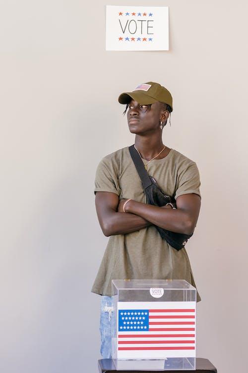 Man Standing Behind Ballot Box