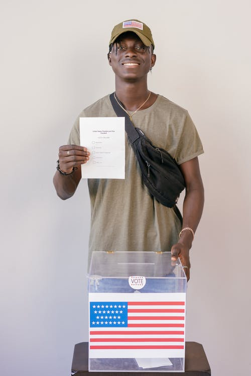 Man Holding a Voter's Paper