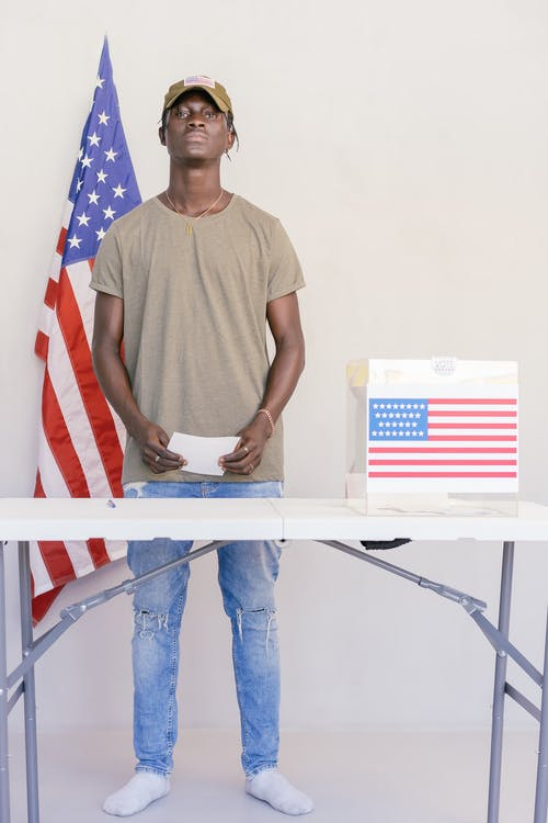 Man Standing Behind Table
