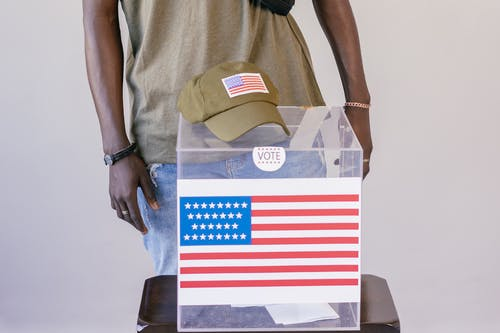 Close Up Photo of Cap on Top of Ballot Box
