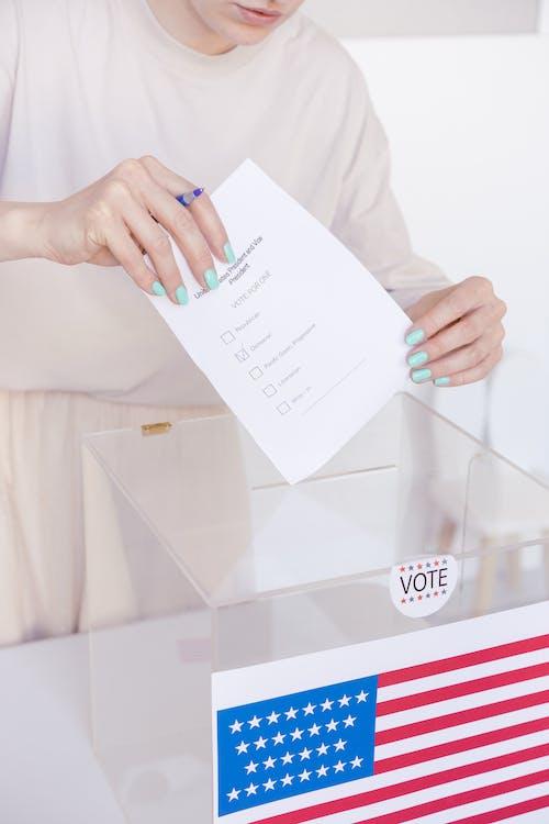 Person Holding White Printer Paper