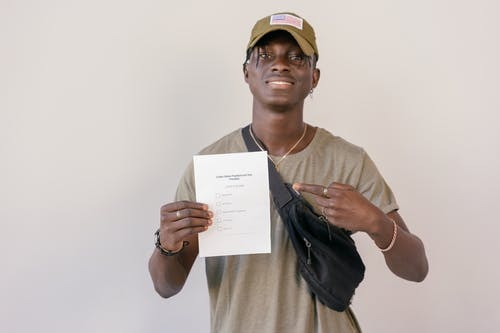 Man Pointing on Paper