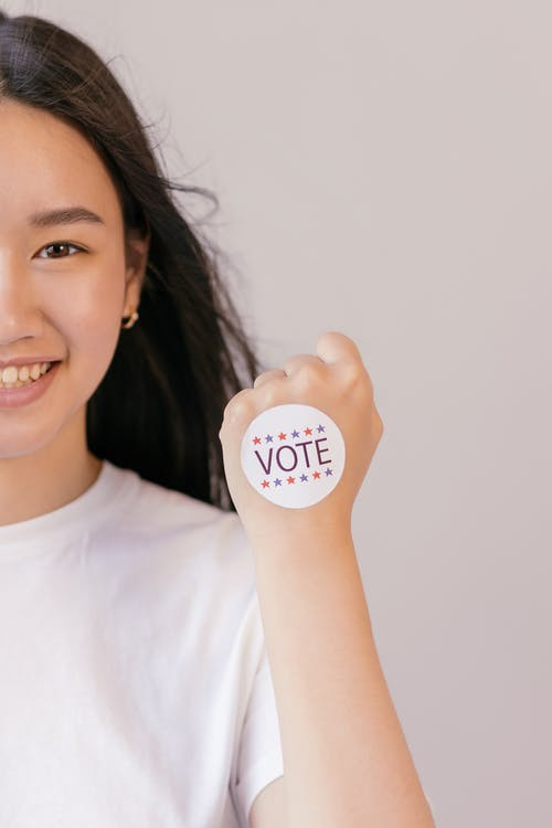 Smiling Woman with Vote Sticker on her Fist